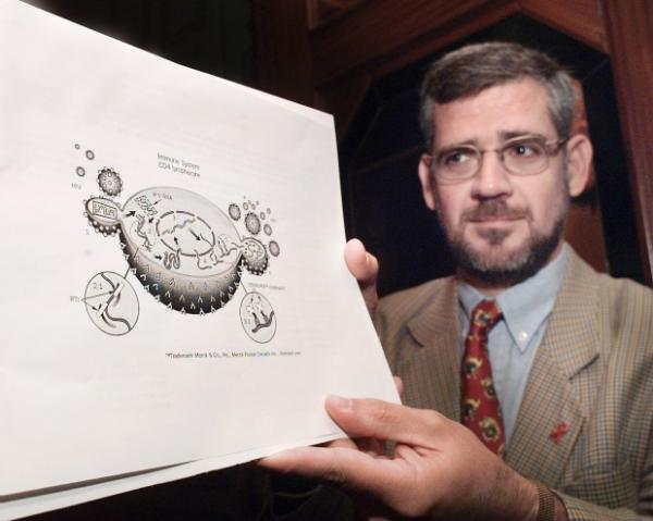 Dr. Julio Montaner, of St. Pauls Hospital, with close-up of cell diagram which new AIDS drug 'Indinavir,' which stops the virus from multiplying in the human cell. St. Paul's Hospital has shut down its dedicated AIDS ward, saying they no longer have enough patients — and the end of AIDS is in sight. Photograph by: Mark van Manen. , VANCOUVER SUN